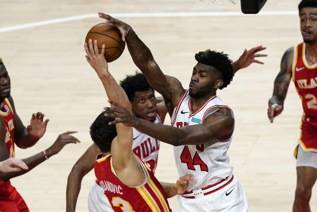 Atlanta Hawks guard Bogdan Bogdanovic (13) has his shot blocked by Chicago Bulls forward Patrick Williams (44) in the first half of an NBA basketball ...