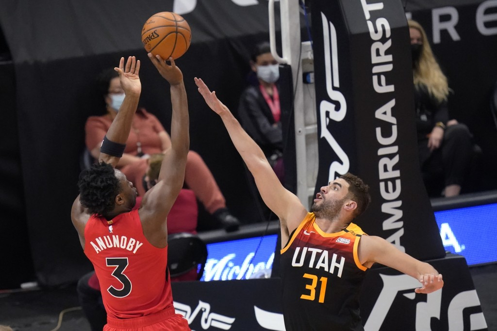 Utah Jazz forward Georges Niang (31) defends as Toronto Raptors forward OG Anunoby (3) shoots during the first half of an NBA basketball game Saturday...