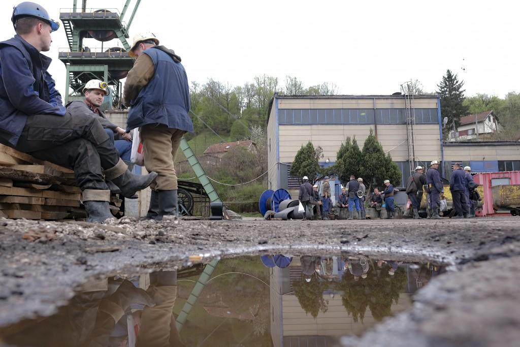 Bosnian coal miners wait outside their mine before their shift in Zenica, Bosnia, Thursday, April 29, 2021. During Ramadan, observant Muslims abstain ...
