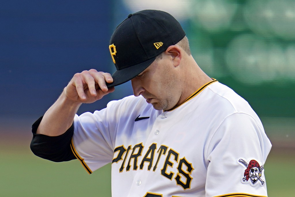 Pittsburgh Pirates starting pitcher Trevor Cahill collects himself on the mound after giving up a three-run home run to St. Louis Cardinals' Paul DeJo...