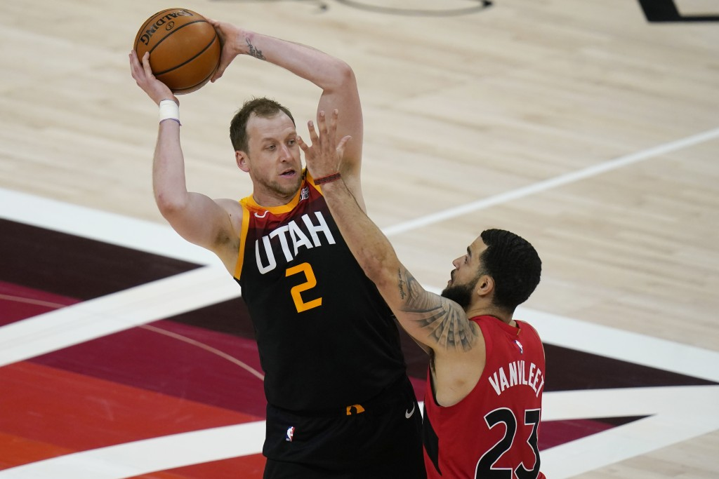 Toronto Raptors guard Fred VanVleet (23) guards Utah Jazz guard Joe Ingles (2) during the first half of an NBA basketball game Saturday, May 1, 2021, ...