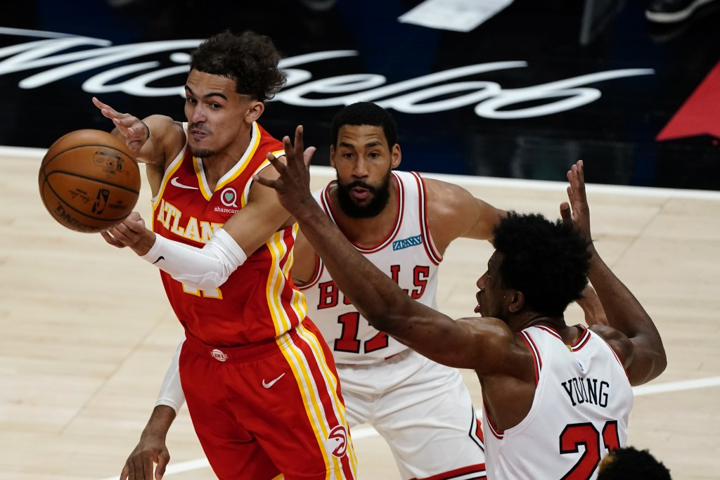 Atlanta Hawks guard Trae Young (11) passes the ball as Chicago Bulls Garrett Temple (17) and Patrick Williams (44) defend in the first half of an NBA ...