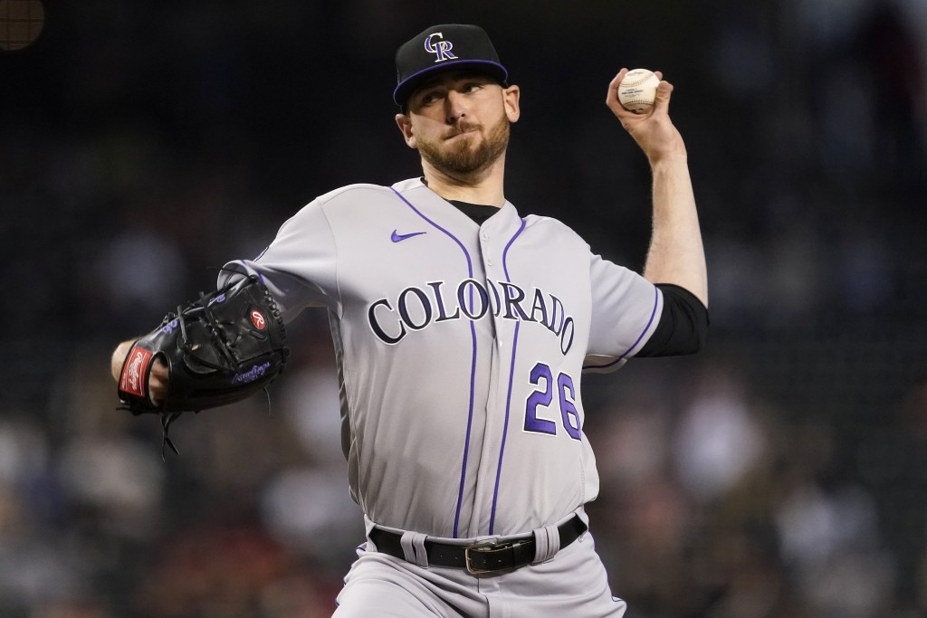 Colorado Rockies starting pitcher Austin Gomber (26) throws against the Arizona Diamondbacks during the first inning of a baseball game, Saturday, May...