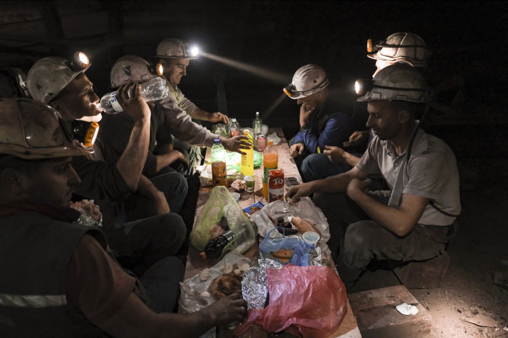 Bosnian coal miners break fast in the underground at a mine in Zenica, Bosnia, Thursday, April 29, 2021. Inside mine shafts, one can't see sunset, but...