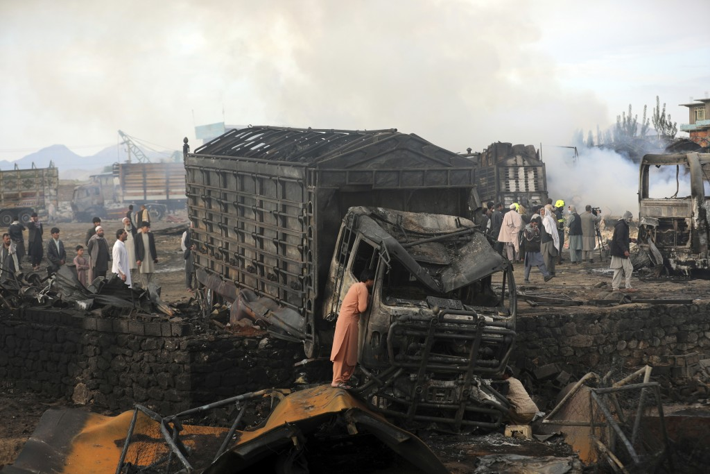 A driver views the damage of his truck caught in a fire in Kabul, Afghanistan, Sunday, May 2, 2021. A fire roared through several fuel tankers on the ...