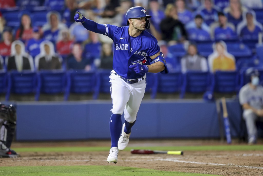 Toronto Blue Jays' Randal Grichuk celebrates after driving in the winning run with a single against the Atlanta Braves during the 10th inning of a bas...