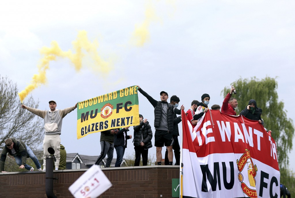 Fans holds up banners as they protest against the Glazer family, owners of Manchester United, before their Premier League match against Liverpool at O...