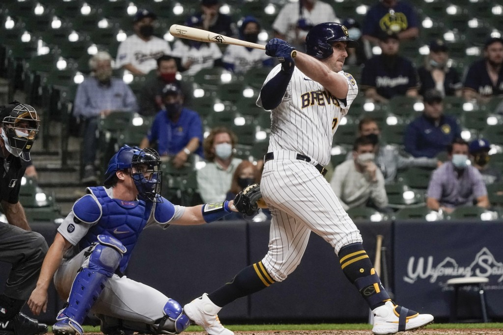 Milwaukee Brewers' Travis Shaw hits the game-winning RBI single during the 11th inning of a baseball game against the Los Angeles Dodgers Saturday, Ma...