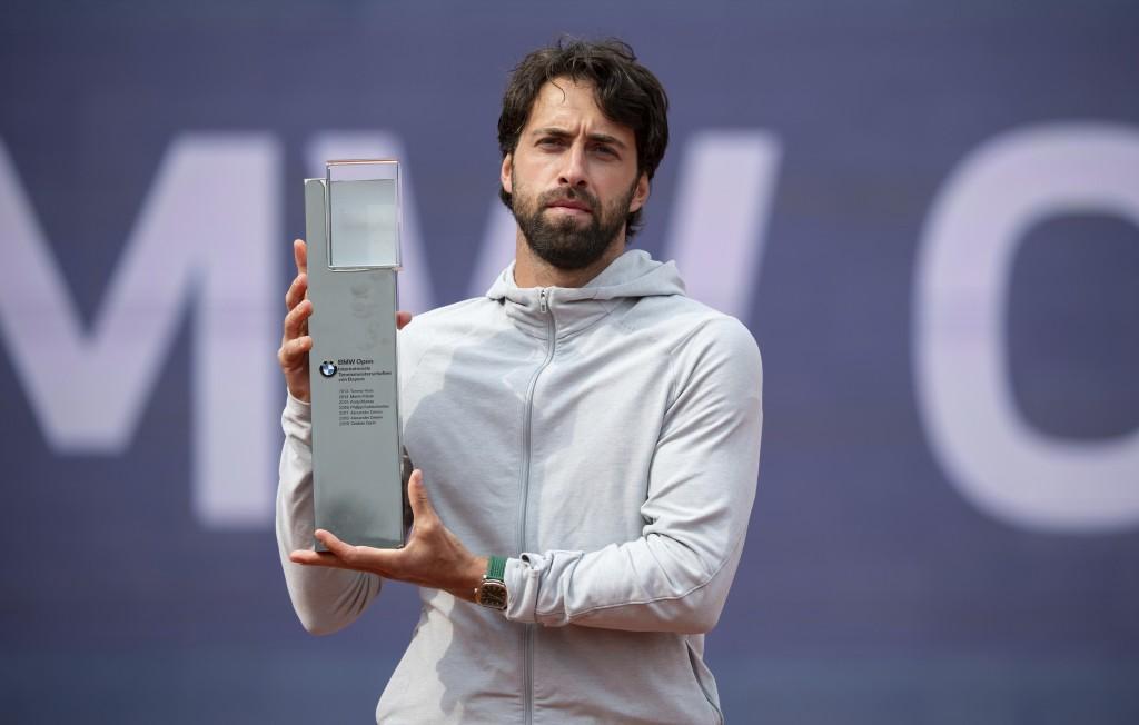 Nikoloz Basilashvili of Georgia lifts the trophy after winning against Jan-Lennard Struff of Germany at the tennis ATP final match in Munich, Germany,...