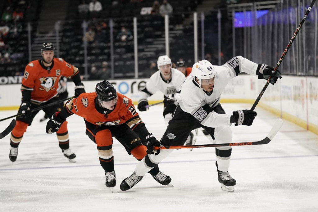 Los Angeles Kings' Quinton Byfield, right, is pressured by Anaheim Ducks' Jamie Drysdale during the first period of an NHL hockey game Saturday, May 1...