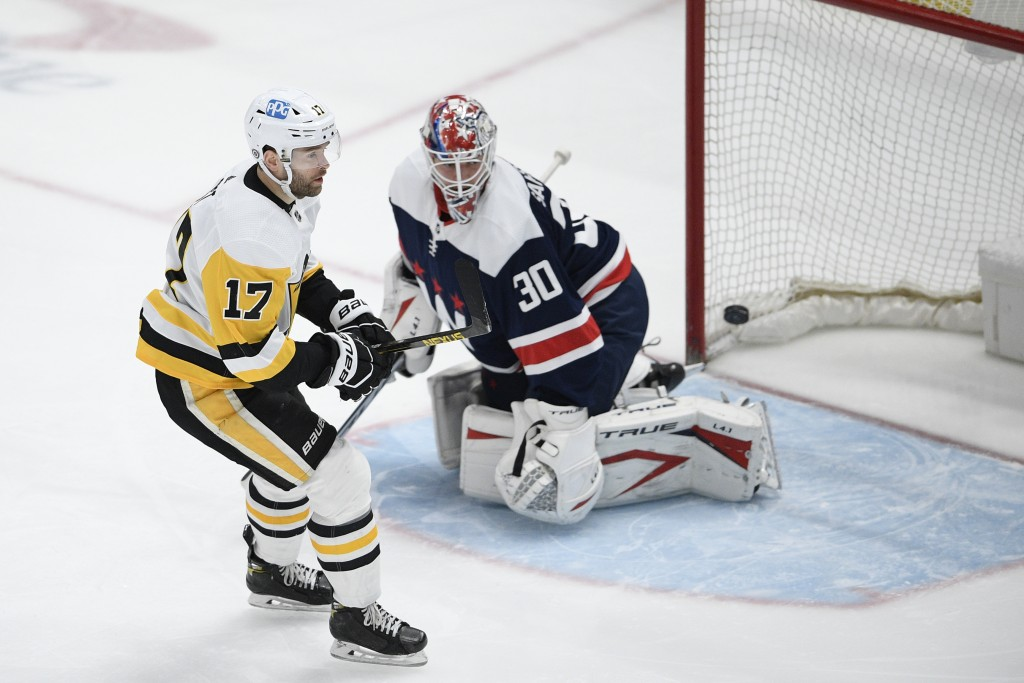 Pittsburgh Penguins right wing Bryan Rust (17) skates by after he scored a goal against Washington Capitals goaltender Ilya Samsonov (30) during the f...