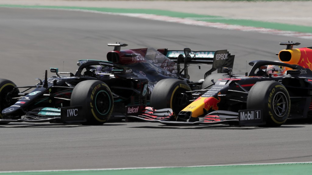 Red Bull driver Max Verstappen of the Netherlands tries to overtake Mercedes driver Lewis Hamilton of Britain, left, during the Portugal Formula One G...