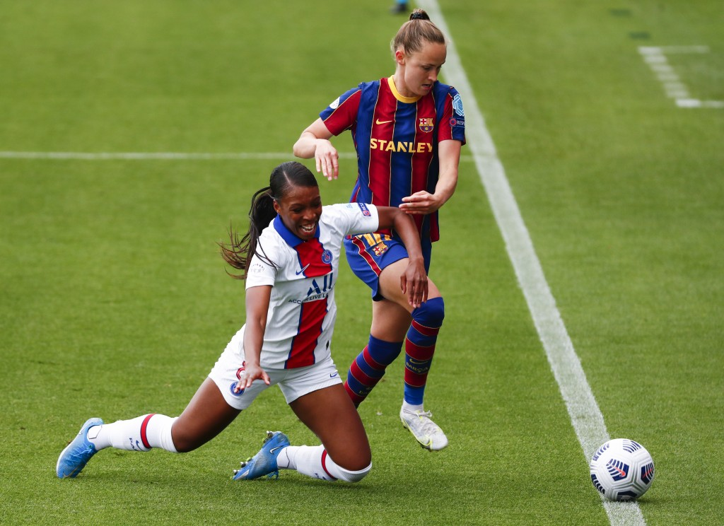 PSG's Grace Geyoro, left, and Barcelona's Caroline Graham Hansen compete for the ball during the Women's Champions League semifinal second leg soccer ...