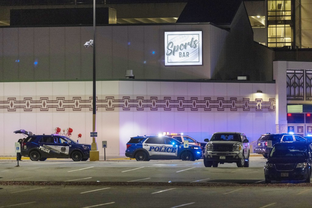 Police line the parking lot outside the Oneida Casino in the early morning hours of Sunday, May 2nd, 2021, near Green Bay, Wisconsin. Authorities in W...