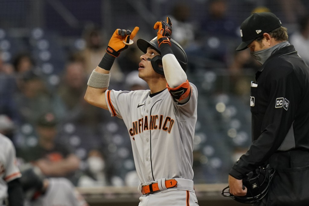 San Francisco Giants' Mauricio Dubon reacts after hitting a home run during the fifth inning of a baseball game against the San Diego Padres, Saturday...