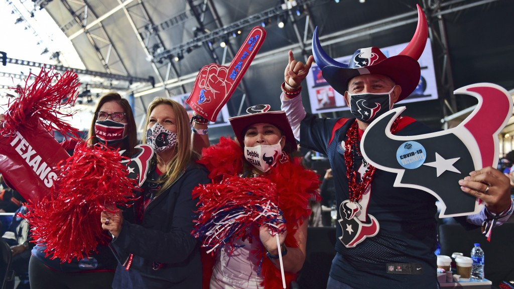 Houston Texans fans celebrate after the Texans selected Brevin Jordan, a tight end from the University of Miami, in the fifth round of the NFL footbal...