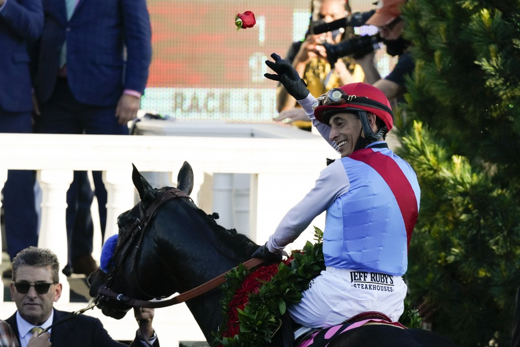 John Velazquez riding Medina Spirit throws a rose after his victory in the 147th running of the Kentucky Derby at Churchill Downs, Saturday, May 1, 20...