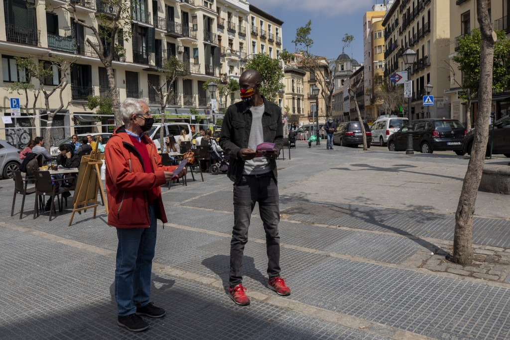 Serigne Mbaye, who is running on a ticket with the anti-austerity United We Can party, in the Madrid regional assembly elections, talks with a potenti...