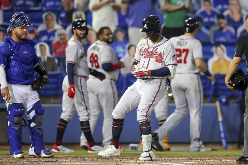 Atlanta Braves Cristian Pache touches home plate in front of Toronto Blue Jays catcher Alejandro Kirk after his grand slam home run during the second ...