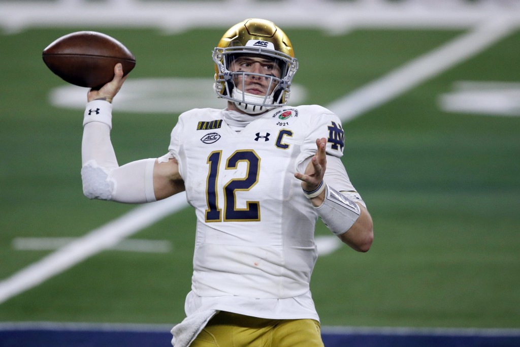 FILE - In this Jan. 1, 2021, file photo, Notre Dame quarterback Ian Book (12) throws a pass in the first half of the Rose Bowl NCAA college football g...