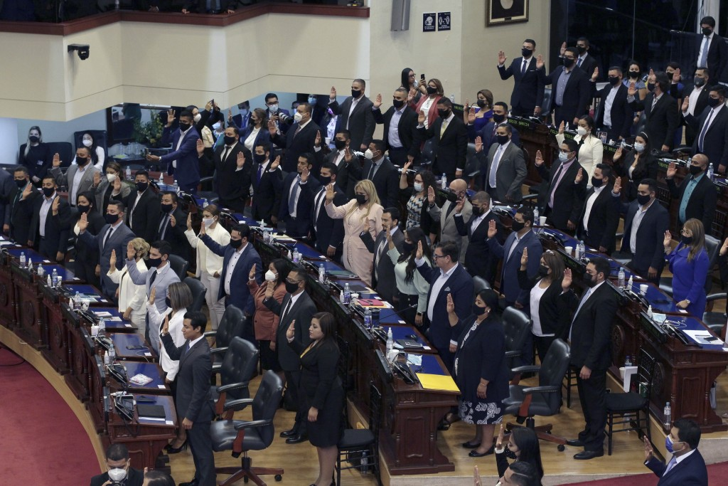 Ruling party New Ideas lawmakers are sworn-in at the Congress in San Salvador, El Salvador, Saturday, May 1, 2021. For the first time in three decades...