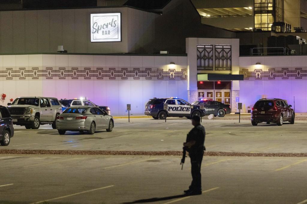 Police stand guard in the parking area outside the Oneida Casino in the early morning hours of Sunday, May 2nd, 2021, near Green Bay, Wisconsin. Autho...