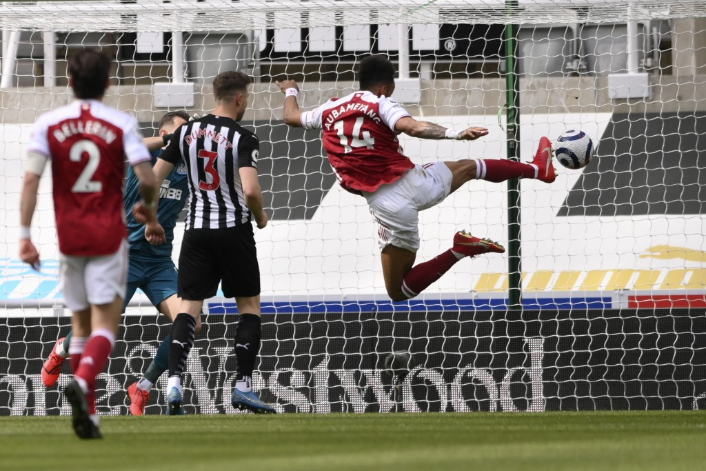 Arsenal's Pierre-Emerick Aubameyang scores his side's second goal during the English Premier League soccer match between Newcastle United and Arsenal ...