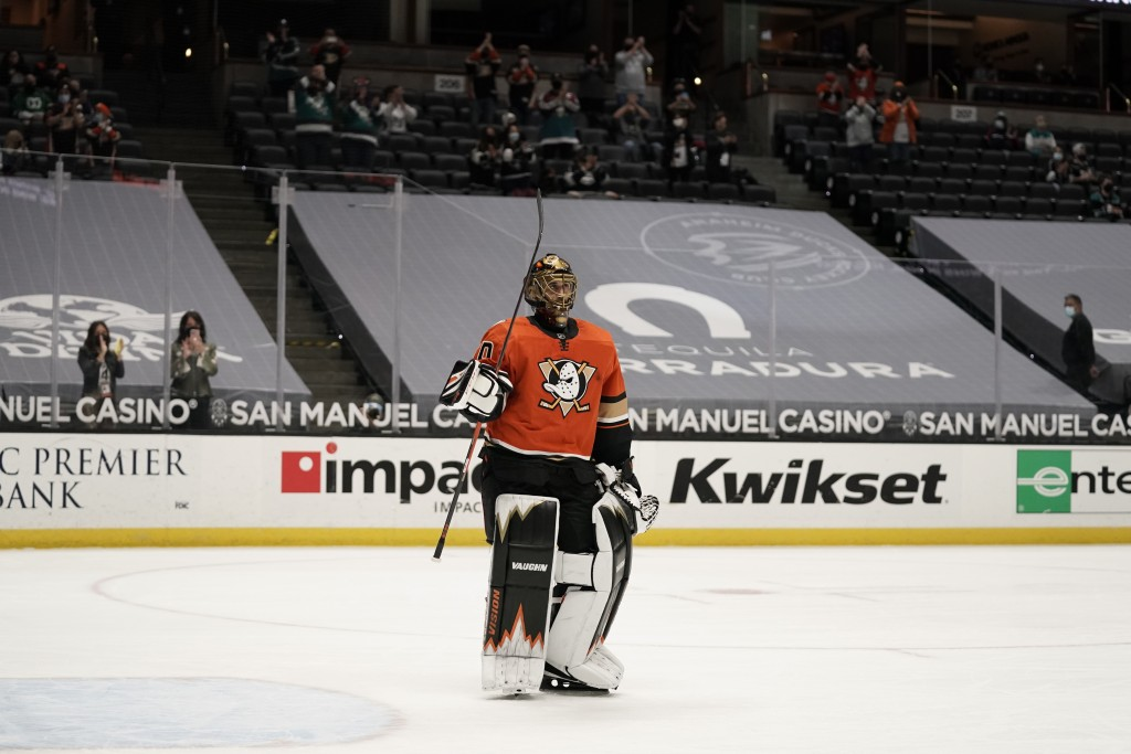 Playing his last home game, Anaheim Ducks goaltender Ryan Miller acknowledges fans during the first period of the team's NHL hockey game against the L...