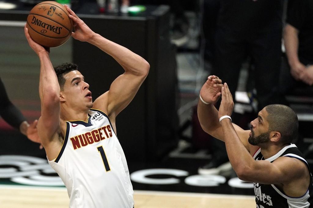 Denver Nuggets forward Michael Porter Jr., left, shoots as Los Angeles Clippers forward Nicolas Batum defends during the first half of an NBA basketba...