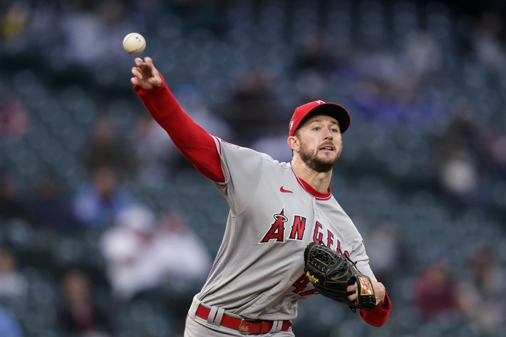 Los Angeles Angels starting pitcher Griffin Canning throws to first base to pick off Seattle Mariners' Jose Marmolejos during the fourth inning of a b...