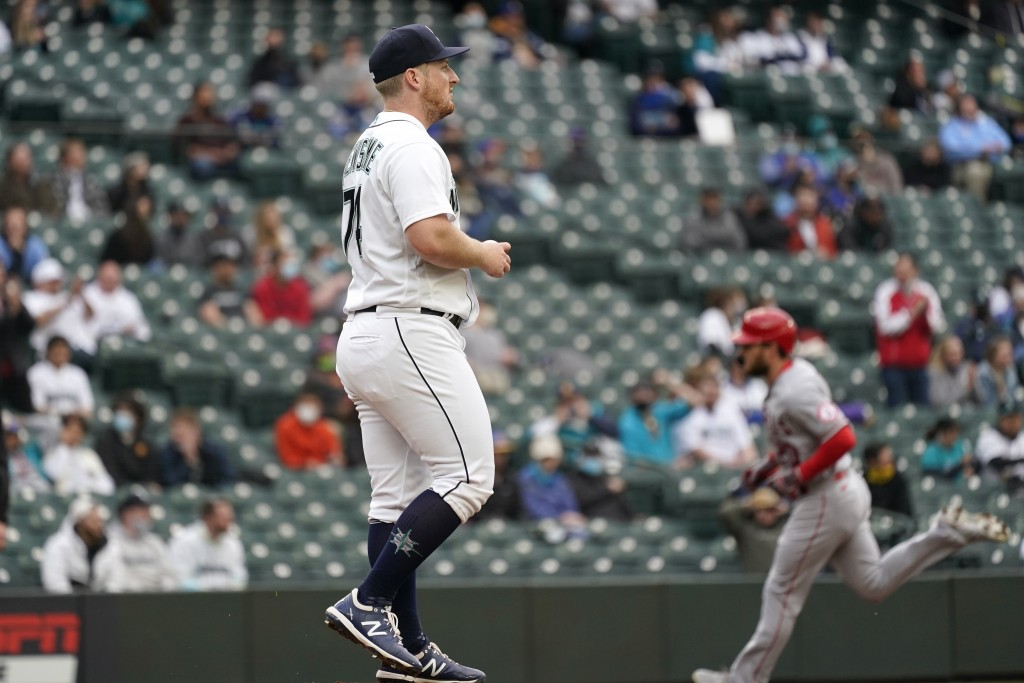 Seattle Mariners starting pitcher Ljay Newsome waits as Los Angeles Angels' Jared Walsh circles the bases on a solo home run during the second inning ...