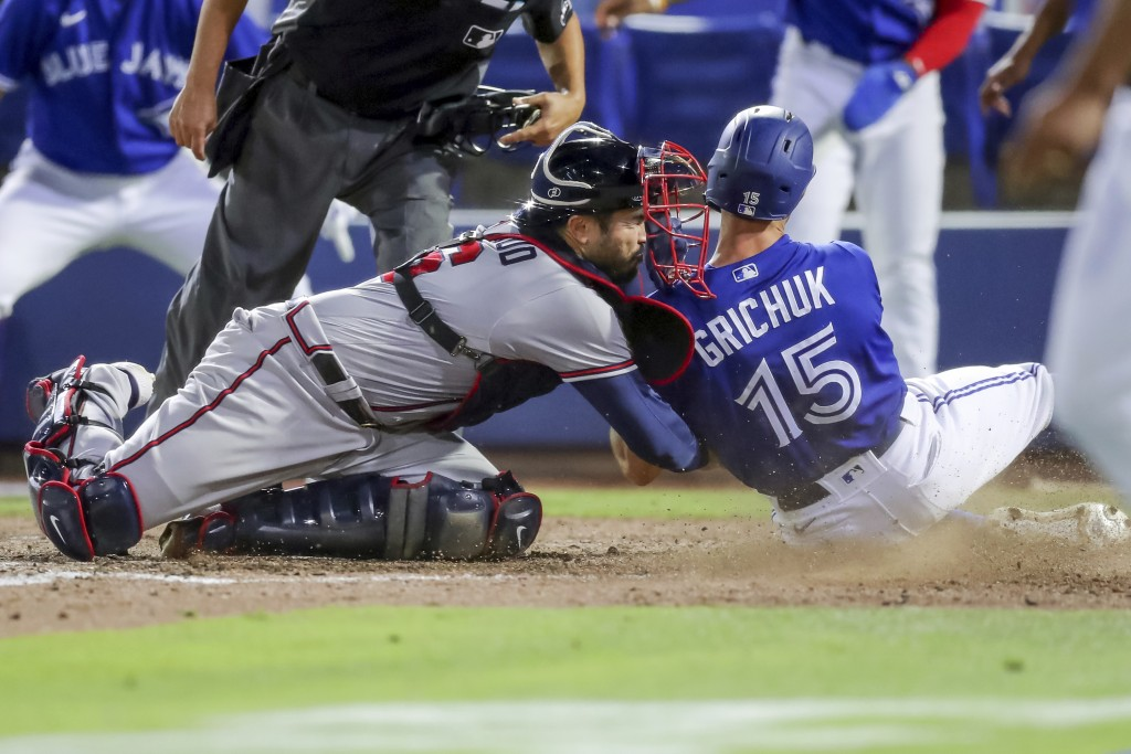Atlanta Braves catcher Travis d'Arnaud tags out Toronto Blue Jays' Randal Grichuk during the sixth inning of a baseball game Saturday, May 1, 2021, in...