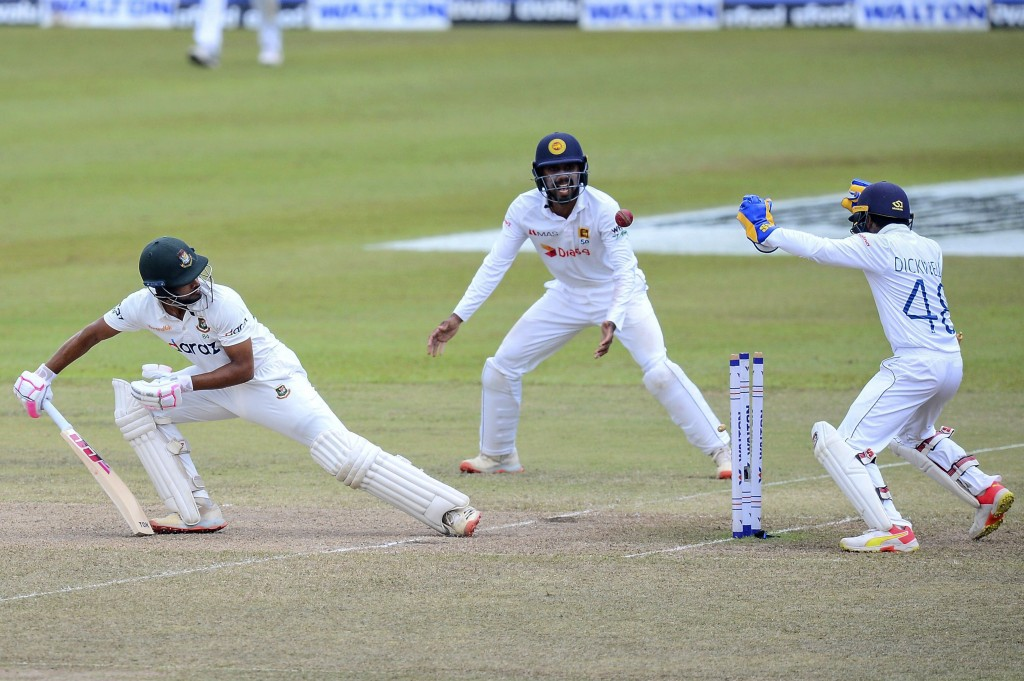 Bangladeshi batsman, Hossain Shanto, looks back at his stumps after being bowled out during the fourth day of the second test cricket match between Sr...