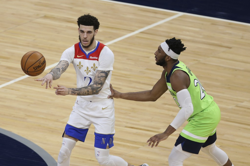 New Orleans Pelicans' Lonzo Ball (2) passes the ball away from Minnesota Timberwolves' Josh Okogie (20) during the first half of an NBA basketball gam...