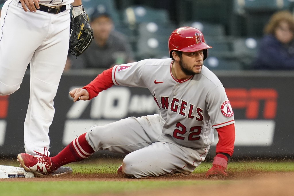 Los Angeles Angels' David Fletcher slides safely into third base against the Seattle Mariners with a steal during the fourth inning of a baseball game...