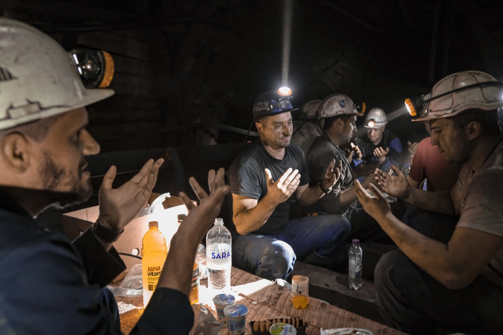 Bosnian coal miners pray after breaking fast in the underground at a mine in Zenica, Bosnia, Thursday, April 29, 2021. Inside mine shafts, one can't s...