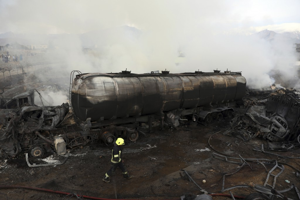 Firefighters work to extinguish a burning fuel tanker in Kabul, Afghanistan, Sunday, May 2, 2021. A fire roared through several fuel tankers on the no...