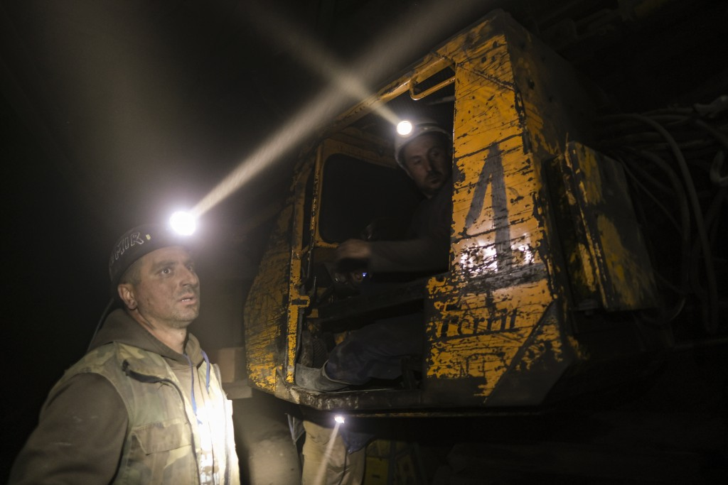 Bosnian coal miners work in an underground tunnel at a mine in Zenica, Bosnia, Thursday, April 29, 2021. During Ramadan, observant Muslims abstain fro...