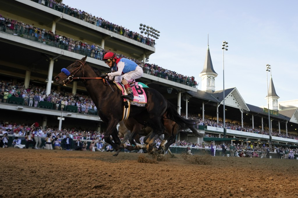 John Velazquez rides Medina Spirit across the finish line to win the 147th running of the Kentucky Derby at Churchill Downs, Saturday, May 1, 2021, in...