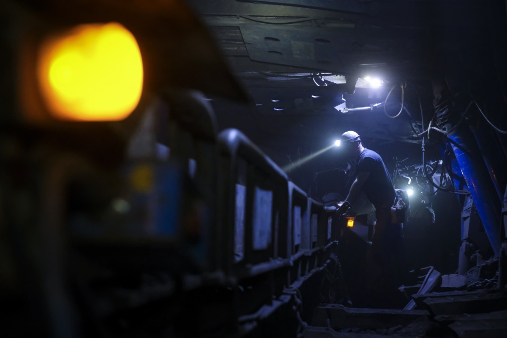 Bosnian coal miners work in an underground tunnel at a mine in Zenica, Bosnia, Thursday, April 29, 2021. Arriving for their shift and assembling for a...
