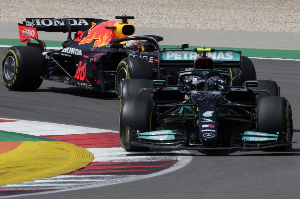 Mercedes driver Valtteri Bottas of Finland takes a curve followed by Red Bull driver Max Verstappen of the Netherlands during the Portugal Formula One...
