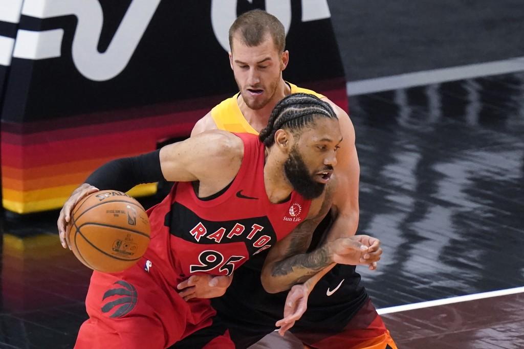 Utah Jazz guard Matt Thomas, rear, defends against Toronto Raptors guard DeAndre' Bembry during the first half of an NBA basketball game Saturday, May...
