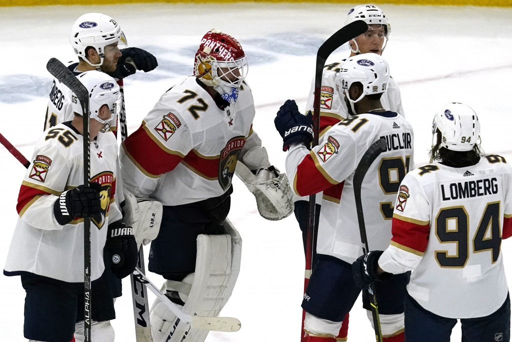 Florida Panthers goaltender Sergei Bobrovsky (72) celebrates with teammates after the Panthers defeated the Chicago Blackhawks 5-4 in an NHL hockey ga...