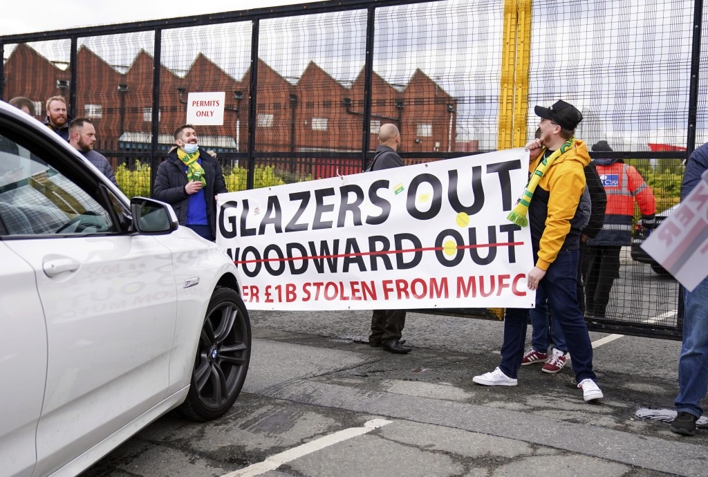 Manchester United fans prevent cars arriving at Old Trafford, during a protest against the Glazer family, owners of Manchester United, before their Pr...