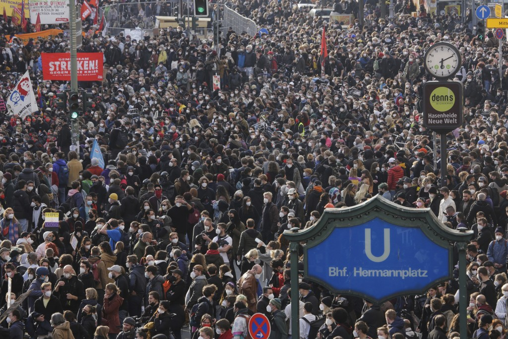 Thousands of protestors attend a May Day rally at the Hermannplatz square in Berlin, Germany, Saturday, May 1, 2021. (AP Photo/Markus Schreiber)