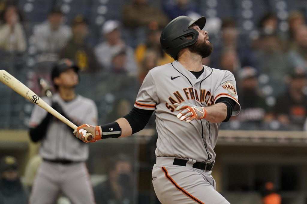 San Francisco Giants' Brandon Belt watches his single during the fourth inning of a baseball game against the San Diego Padres, Saturday, May 1, 2021,...