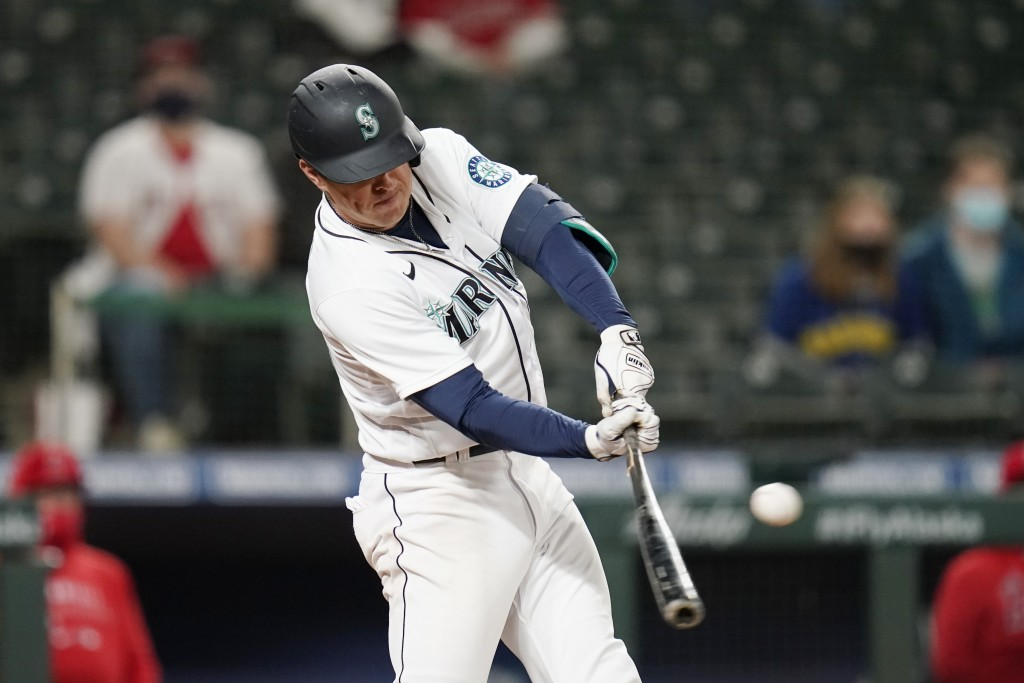 Seattle Mariners' Dylan Moore hits a two-run single against the Los Angeles Angels during the eighth inning of a baseball game Saturday, May 1, 2021, ...