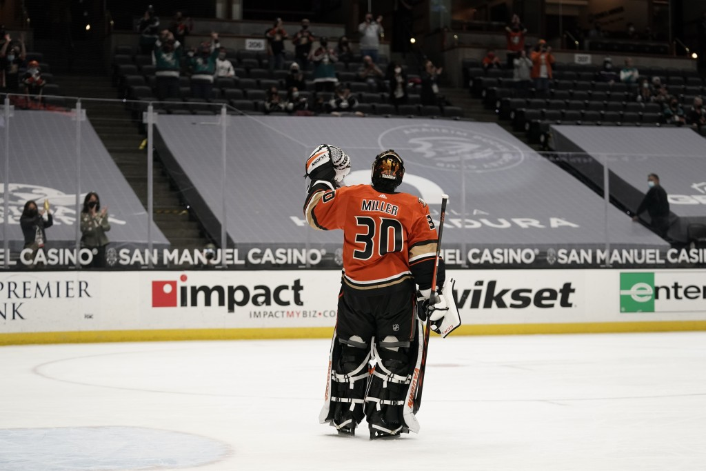 Playing his last home game, Anaheim Ducks goaltender Ryan Miller acknowledges the fans during the first period of the team's NHL hockey game against t...