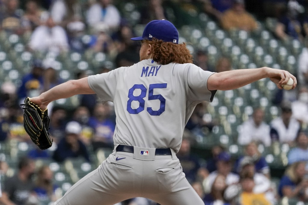Los Angeles Dodgers' Dustin May throws during the first inning of a baseball game against the Milwaukee Brewers Saturday, May 1, 2021, in Milwaukee. (...