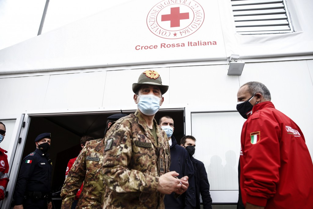 Italy's commissioner for COVID emergency Francesco Paolo Figliuolo, center, visits a new vaccination hub for coronavirus at the Porta di Roma shopping...